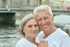 Elderly couple having rest near river Royalty Free Stock Images