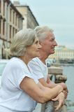Elderly couple having rest near river Stock Photos