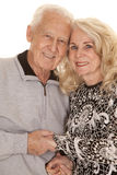 Elderly couple heads close hold hands Royalty Free Stock Image