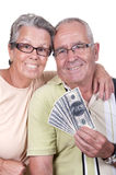 Elderly couple holding bills Royalty Free Stock Photography