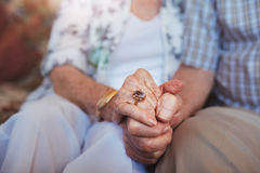 Free Elderly Couple Holding Hands Stock Images - 71515034
