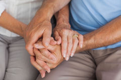 Elderly couple holding hands. Close up of an elderly couple holding hands stock photography