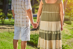 Elderly couple holding hands. royalty free stock photos