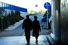 An elderly couple holding hands on the street. This is Love! royalty free stock image