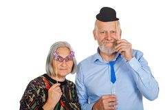 Elderly couple holding photo accessories stock images