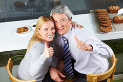 Elderly couple holding thumbs up Stock Image