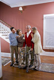 Elderly couple at home with adult children stock photography