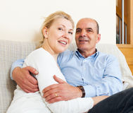 Elderly couple hug with happiness and sitiing Stock Images