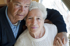 Elderly couple hugging Stock Images