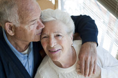Elderly couple hugging Stock Photos