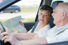 Elderly couple inside car. Elderly couple inside the car stock images