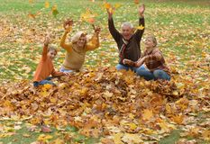 Elderly couple and kids having fun Stock Photos