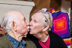 Elderly Couple Kissing Stock Images