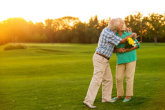 Elderly couple is kissing. Royalty Free Stock Photography