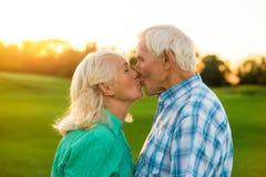 Elderly couple kissing. Stock Images