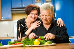 Elderly couple at kitchen Stock Photo