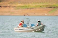 Elderly couple on the lake fishing royalty free stock photos