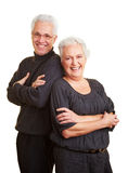 Elderly couple leaning on each Stock Images