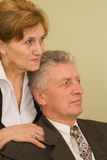 Elderly couple looking into the distance Stock Photography