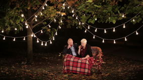 Elderly couple in love talking to each other and drinking tea. HD stock video footage