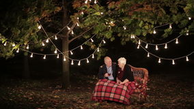 Elderly couple in love talking to each other and drinking tea. HD stock video
