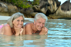 Elderly couple lying on the beach Royalty Free Stock Image