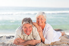 Elderly couple lying down Royalty Free Stock Photos