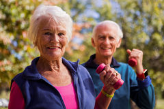 Elderly couple making fitness and lifting hand weight Royalty Free Stock Photo