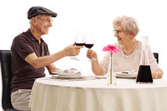 Elderly couple making a toast Stock Photo