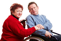 Elderly couple with man Stock Photos