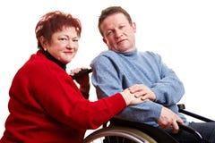 Elderly couple with man Stock Photos