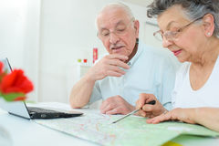 Elderly couple mapping route Stock Photos