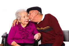 Elderly couple. Elderly married couple on a white background stock photo
