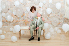 Elderly couple. Mature couple relaxing on a bench enjoying each other's company Stock Images