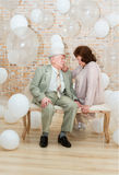 Elderly couple. Mature couple relaxing on a bench enjoying each other's company Royalty Free Stock Photography