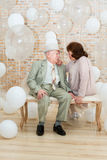 Elderly couple. Mature couple relaxing on a bench enjoying each other's company Stock Photos
