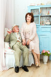 Elderly couple. Mature couple relaxing on a bench enjoying each other's company Royalty Free Stock Images