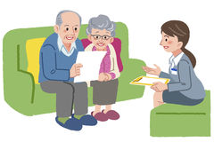 Elderly couple meeting with Geriatric care manager. Elderly couple consults with Geriatric care manager or travel agent Royalty Free Stock Photography
