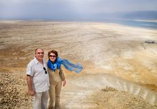 Elderly couple in mountains overlooking Dead Sea Stock Photos