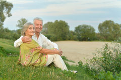 Elderly  couple on nature  at summer Stock Images