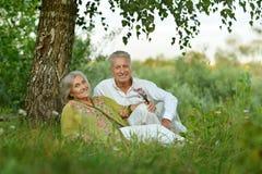 Elderly  couple on nature  at summer Stock Photo
