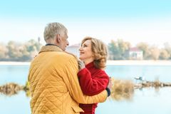 Elderly couple near river stock images