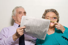 Elderly couple with newspaper Royalty Free Stock Photography