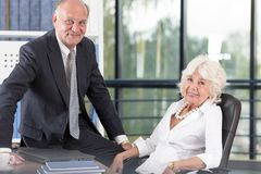Elderly couple in office Stock Images