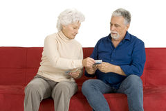 Elderly Couple On The Couch With Money In Hand Stock Image