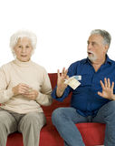 Elderly Couple On The Couch With Money In Hand Stock Photography