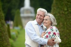 Elderly couple outdoors. Portrait of cute happy elderly couple outdoors Stock Photos