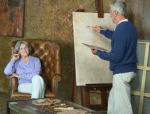 Elderly couple painting with easel Royalty Free Stock Photo