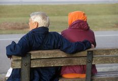 Elderly couple in the park. Elderly couple sitting on a park bench Stock Photography