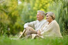 Elderly couple in the park. Beautiful caucasian elderly couple in the park in autumn Royalty Free Stock Image